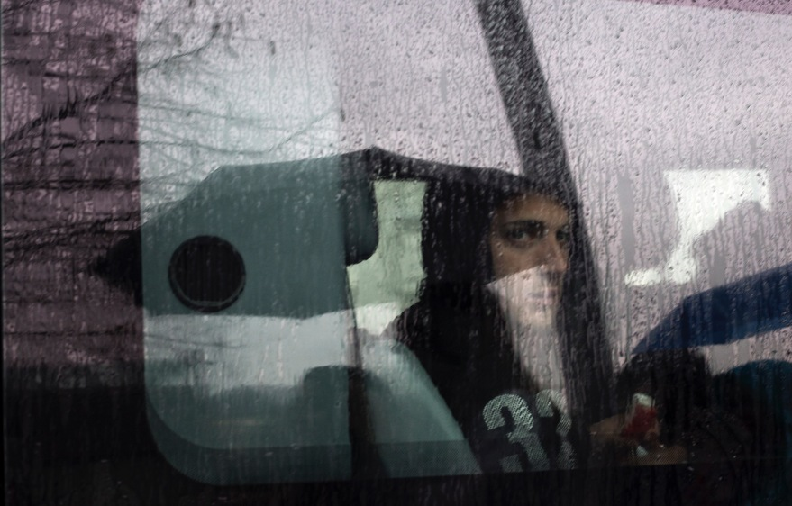 A man sits in a car on a rainy day in Budapest, Hungary.
